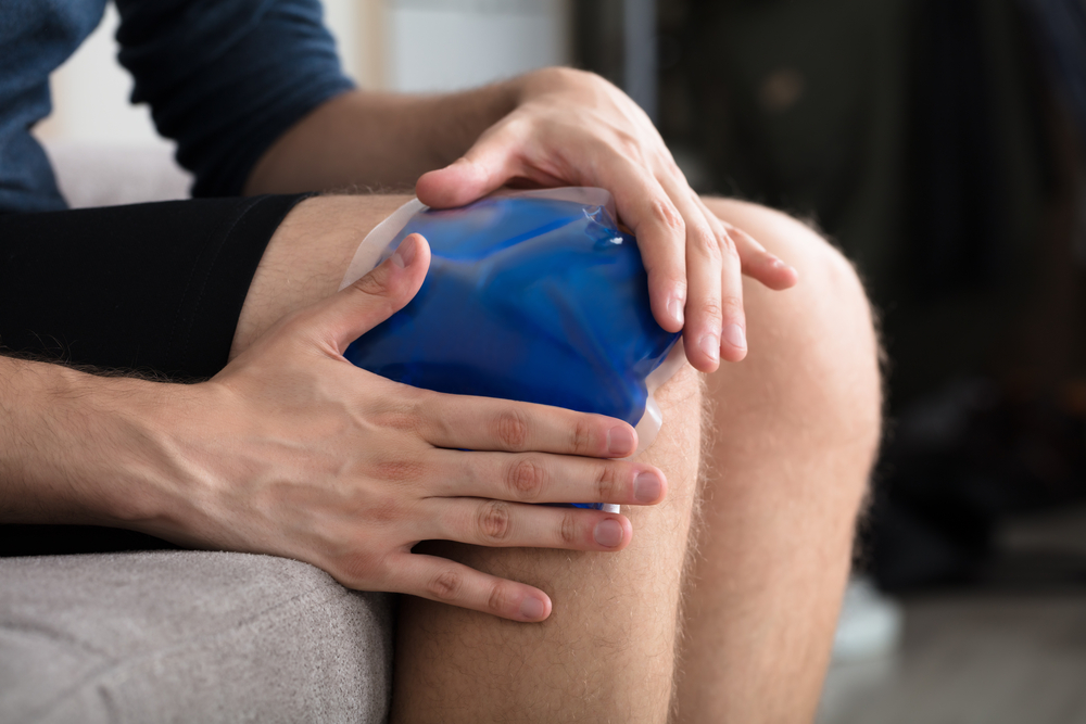 Person Icing their sore knee while it's bent