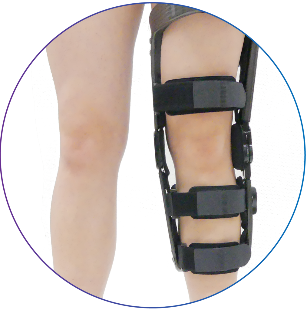 Person wearing a hinged knee brace.