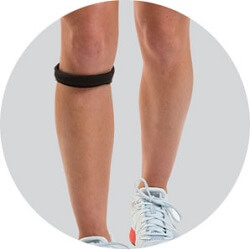 Person wearing a patellar knee strap.