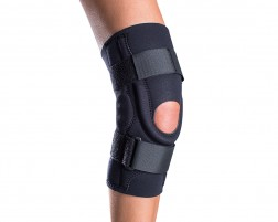 compression knee sleeve with buttress and cutout for patella